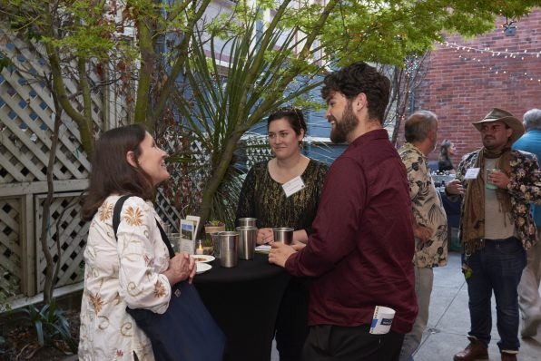 Attendees deep in discussion about the incredible film lineup!