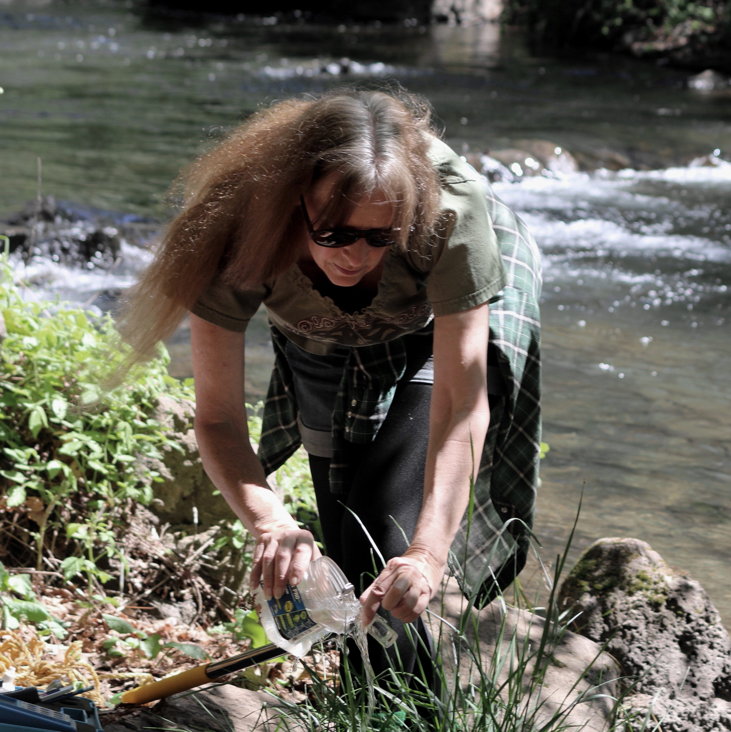 Marily Woodhouse takes water sample